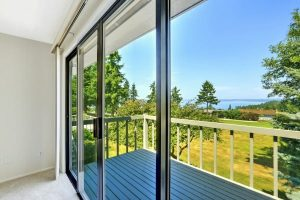 House with water view. Walkout deck with glass slide door