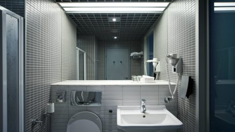 What Causes Dark Spots in Bathroom Mirrors and Can They Be Prevented?